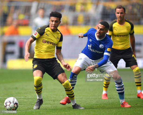 Jadon Sancho of Borussia Dortmund evades Omar Mascarell of FC Schalke 04 during the Bundesliga match between Borussia Dortmund and FC Schalke 04 at...