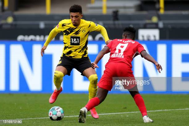 Jadon Sancho of Borussia Dortmund is challenged by Amadou Haidara of RB Leipzig during the Bundesliga match between Borussia Dortmund and RB Leipzig...