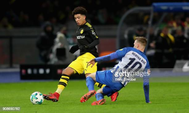 Jadon Sancho of Borussia Dortmund is challenged by Ondrej Duda of Hertha BSC during the Bundesliga match between Hertha BSC and Borussia Dortmund at...