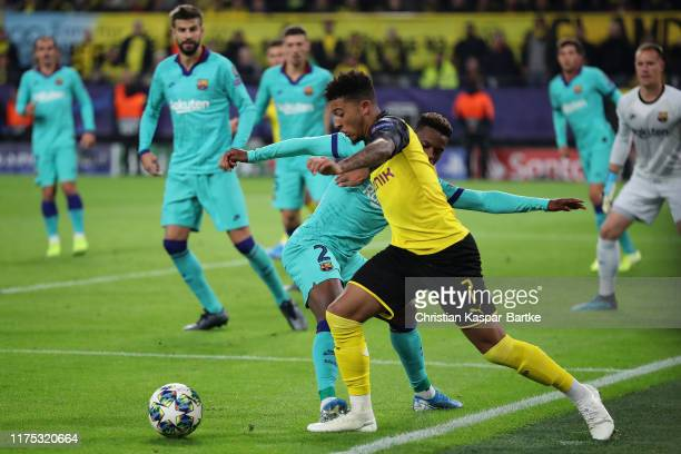 Jadon Sancho of Borussia Dortmund is fouled by Nelson Semedo of FC Barcelona for a penalty during the UEFA Champions League group F match between...