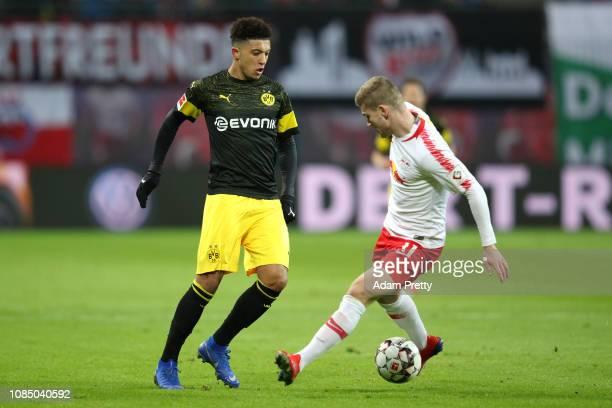 Jadon Sancho of Borussia Dortmund nutmegs Timo Werner of RB Leipzig during the Bundesliga match between RB Leipzig and Borussia Dortmund at Red Bull...