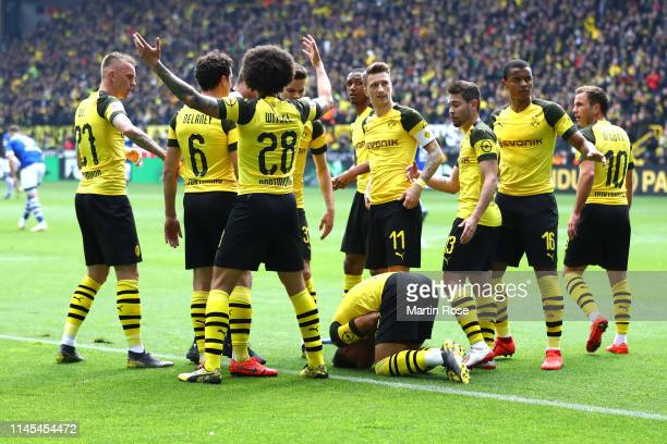 Jadon Sancho of Borussia Dortmund reacts as he is hit by an object as they celebrate their first goal during the Bundesliga match between Borussia...
