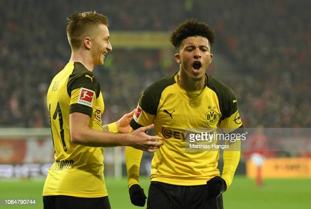 Jadon Sancho of Borussia Dortmund reacts with team mate Marco Reus of Borussia Dortmund during the Bundesliga match between 1 FSV Mainz 05 and...