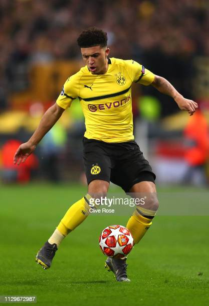 Jadon Sancho of Borussia Dortmund runs with the ball during the UEFA Champions League Round of 16 First Leg match between Tottenham Hotspur and...