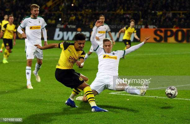 Jadon Sancho of Borussia Dortmund scores his side's first goal during the Bundesliga match between Borussia Dortmund and Borussia Moenchengladbach at...