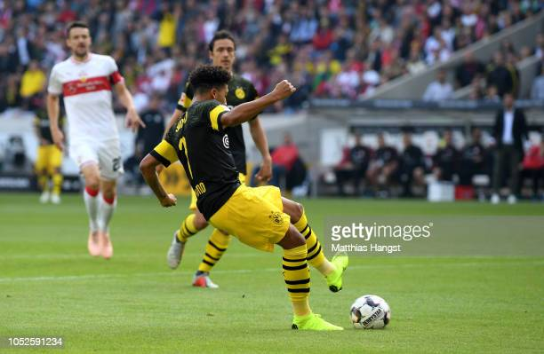 Jadon Sancho of Borussia Dortmund scores his team's first goal during the Bundesliga match between VfB Stuttgart and Borussia Dortmund at...