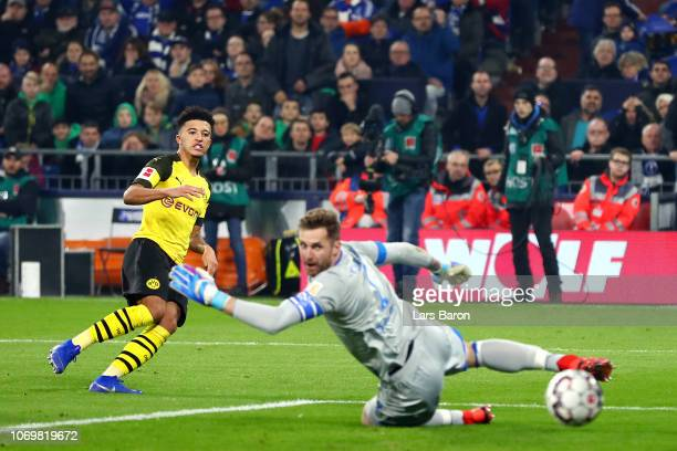 Jadon Sancho of Borussia Dortmund scores his team's second goal during the Bundesliga match between FC Schalke 04 and Borussia Dortmund at...