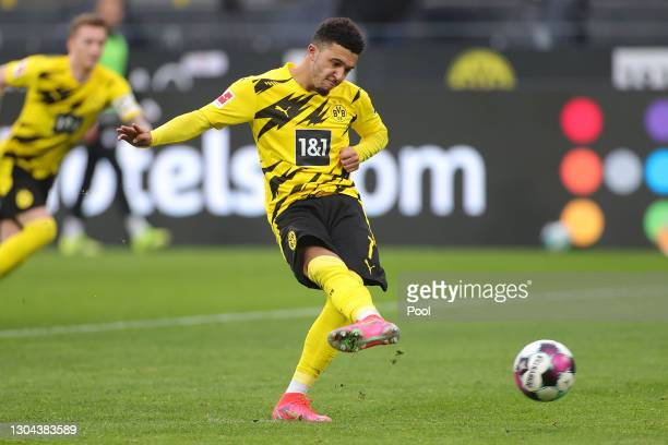Jadon Sancho of Borussia Dortmund scores their side's second goal from the penalty spot during the Bundesliga match between Borussia Dortmund and DSC...
