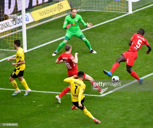 Jadon Sancho of Borussia Dortmund scores their side's second goal past Peter Gulacsi of RB Leipzig during the Bundesliga match between Borussia...