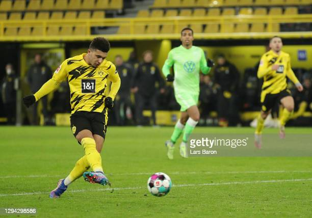 Jadon Sancho of Borussia Dortmund scores their sides second goal during the Bundesliga match between Borussia Dortmund and VfL Wolfsburg at Signal...