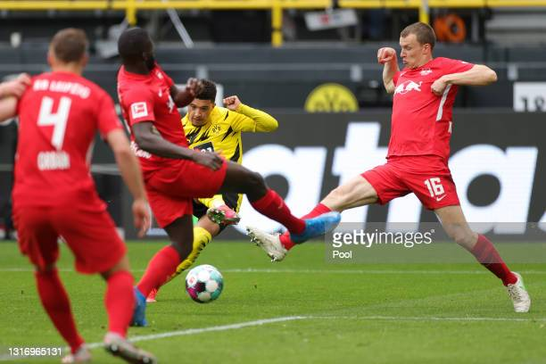 Jadon Sancho of Borussia Dortmund scores their side's second goal during the Bundesliga match between Borussia Dortmund and RB Leipzig at Signal...