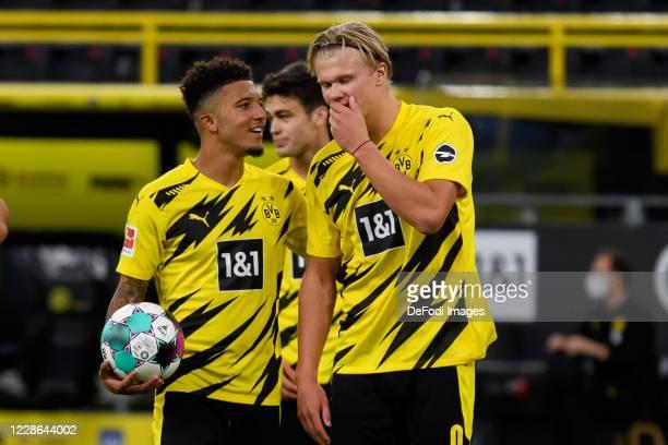 Jadon Sancho of Borussia Dortmund speaks with Erling Haaland of Borussia Dortmund who takes the penalty during the Bundesliga match between Borussia...