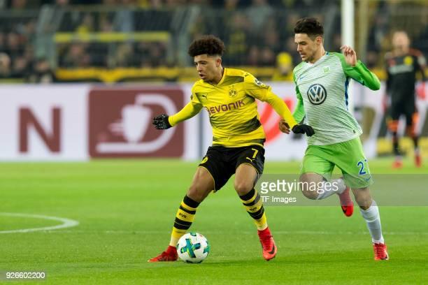 Jadon Sancho of Dortmund and Josip Brekalo of Wolfsburg battle for the ball during the Bundesliga match between Borussia Dortmund and VfL Wolfsburg...