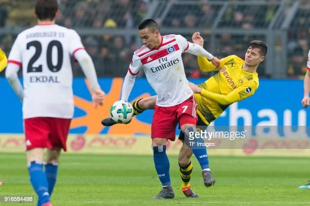 Jadon Sancho of Dortmund and Julian Weigl of Dortmund battle for the ball during the Bundesliga match between Borussia Dortmund and Hamburger SV at...