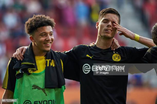 Jadon Sancho of Dortmund and Julian Weigl of Dortmund looks on during the Bundesliga match between FC Augsburg and Borussia Dortmund at WWKArena on...