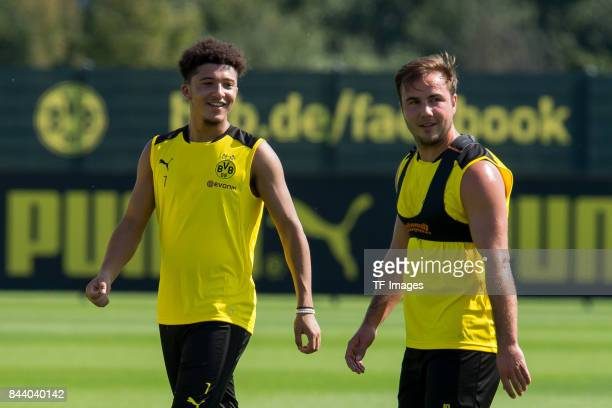 Jadon Sancho of Dortmund and Mario Goetze of Dortmund laughs during a training session at the BVB Training center on September 4 2017 in Dortmund...
