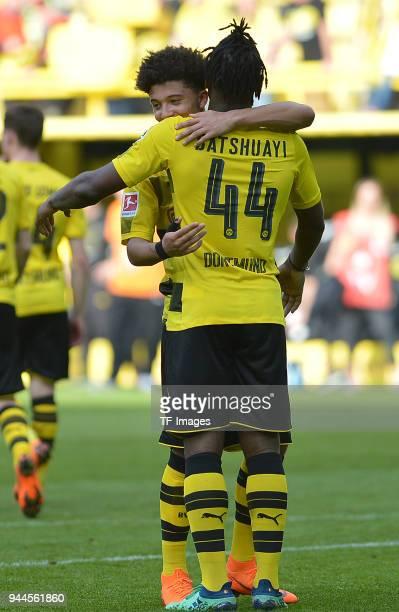 Jadon Sancho of Dortmund and Michy Batshuayi of Dortmund celebrate after winning the Bundesliga match between Borussia Dortmund and VfB Stuttgart at...