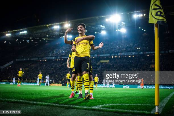 Jadon Sancho of Dortmund celebrates his teams second goal with Aschraf Hakimi of Dortmund during the Bundesliga match between Borussia Dortmund and...