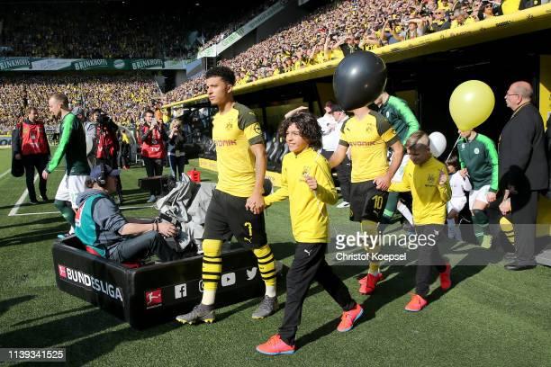 Jadon Sancho of Dortmund enters the pitch prior to the Bundesliga match between Borussia Dortmund and VfL Wolfsburg at Signal Iduna Park on March 30...