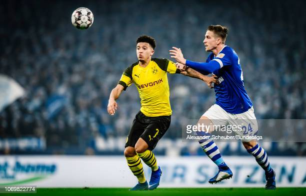 Jadon Sancho of Dortmund in action against Bastian Oczipka of Schalke during the Bundesliga match between FC Schalke 04 and Borussia Dortmund at...