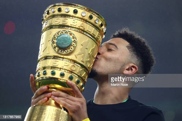 Jadon Sancho of Dortmund kisses the trophy after winning the DFB Cup final match between RB Leipzig and Borussia Dortmund at Olympic Stadium on May...