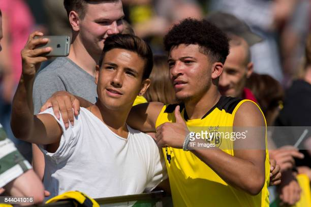 Jadon Sancho of Dortmund make a selfie with a fan during a training session at the BVB Training center on September 4 2017 in Dortmund Germany