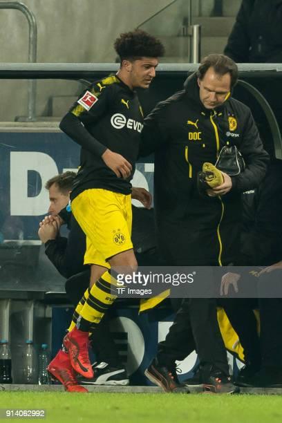 Jadon Sancho of Dortmund receives help from Dr Markus Braun of Dortmund during the Bundesliga match between 1 FC Koeln and Borussia Dortmund at...