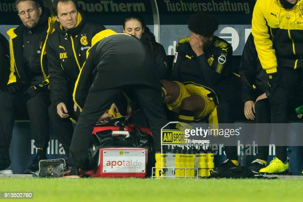 Jadon Sancho of Dortmund receives medical help during the Bundesliga match between 1 FC Koeln and Borussia Dortmund at RheinEnergieStadion on...