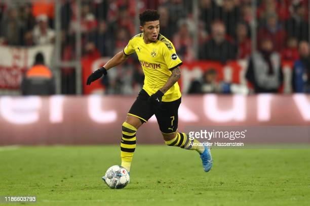 Jadon Sancho of Dortmund runs with the ball during the Bundesliga match between FC Bayern Muenchen and Borussia Dortmund at Allianz Arena on November...