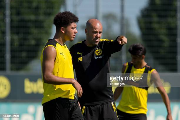 Jadon Sancho of Dortmund speak with Head coach Peter Bosz of Dortmund during a training session at the BVB Training center on September 4 2017 in...
