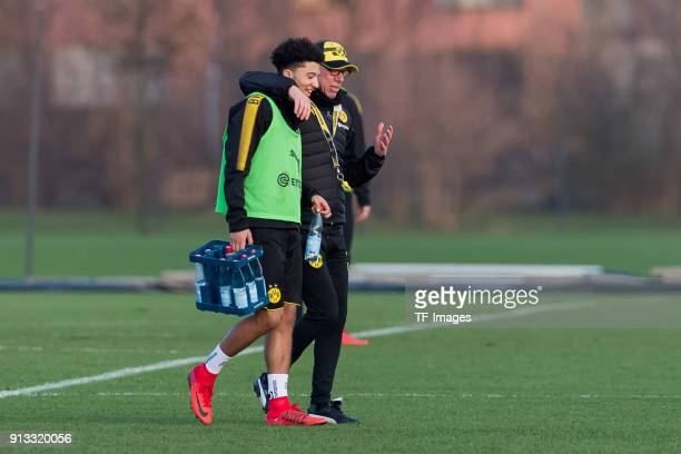 Jadon Sancho of Dortmund speaks with Head coach Peter Stoeger of Dortmund during a training session at BVB trainings center on January 30 2018 in...