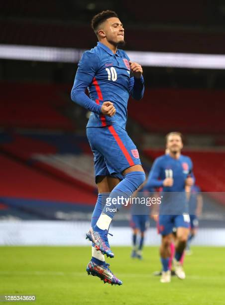 Jadon Sancho of England celebrates after scoring his team's second goal during the international friendly match between England and the Republic of...