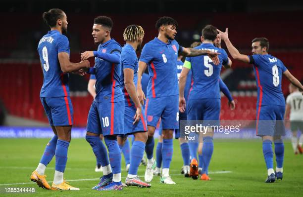 Jadon Sancho of England celebrates with his team after scoring his team's second goal during the international friendly match between England and the...