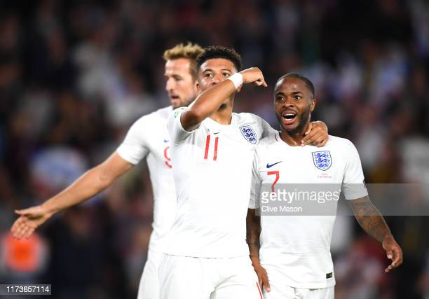 Jadon Sancho of England celebrates with team mates Raheem Sterling after scoring his sides fifth goal during the UEFA Euro 2020 qualifier match...