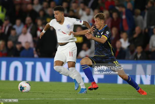 Jadon Sancho of England has his shirt pulled by Mergim Vojvoda of Kosovo during the UEFA Euro 2020 qualifier match between England and Kosovo at St...