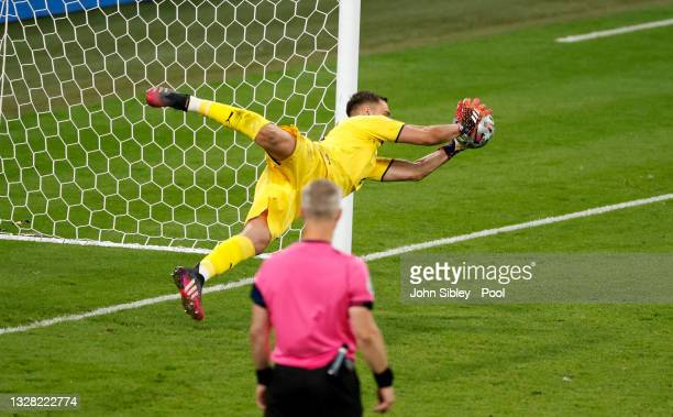 Jadon Sancho of England has their team's fourth penalty in the penalty shoot out saved by Gianluigi Donnarumma of Italy during the UEFA Euro 2020...