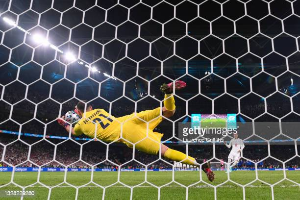 Jadon Sancho of England has their team's fourth penalty saved by Gianluigi Donnarumma of Italy in a penalty shoot out during the UEFA Euro 2020...
