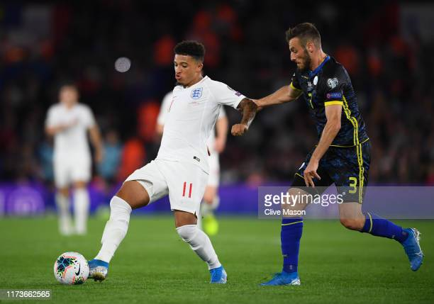 Jadon Sancho of England is tackled by Fidan Aliti of Kosovo during the UEFA Euro 2020 qualifier match between England and Kosovo at St. Mary's...