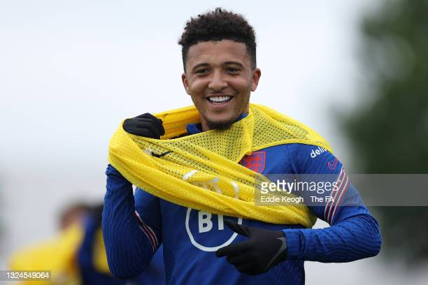 Jadon Sancho of England looks on during the England Training Session at Tottenham Hotspur Training Ground on June 20, 2021 in Burton upon Trent,...
