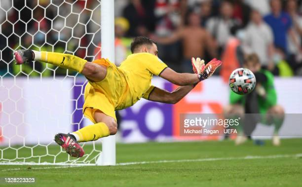 Jadon Sancho of England misses his team's sixth penalty in a penalty shoot out which is saved by Gianluigi Donnarumma of Italy during the penalty...