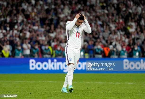 Jadon Sancho of England reacts after missing their team's fourth penalty in the penalty shoot out during the UEFA Euro 2020 Championship Final...