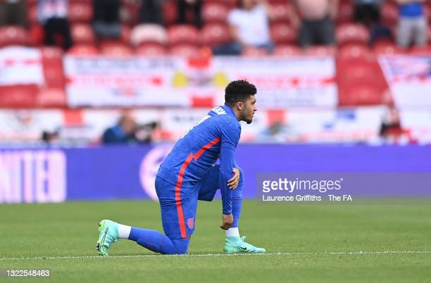 Jadon Sancho of England takes a knee in support of the Black Lives Matter movement ahead of the international friendly match between England and...