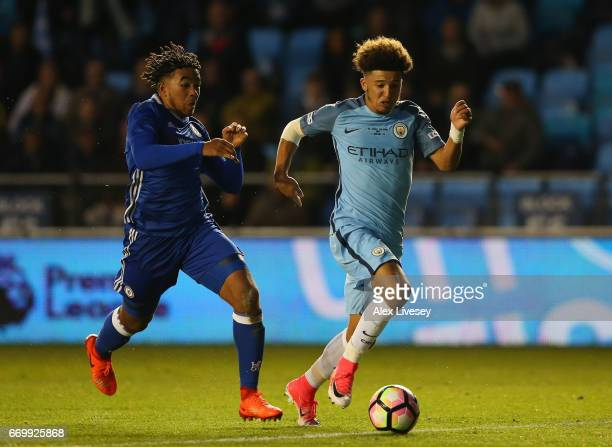 Jadon Sancho of Manchester City takes the ball past Reece James of Chelsea during the FA Youth Cup Final First Leg match between Manchester City and...