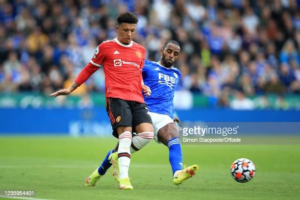 Jadon Sancho of Manchester United battles with Ricardo Pereira of Leicester City during the Premier League match between Leicester City and...