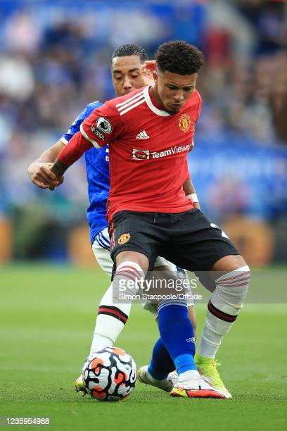 Jadon Sancho of Manchester United battles with Youri Tielemans of Leicester City during the Premier League match between Leicester City and...