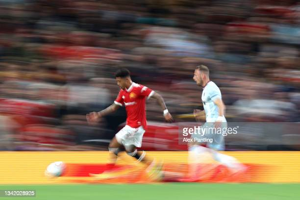 Jadon Sancho of Manchester United is closed down by Vladimir Coufal of West Ham during the Carabao Cup Third Round match between Manchester United...