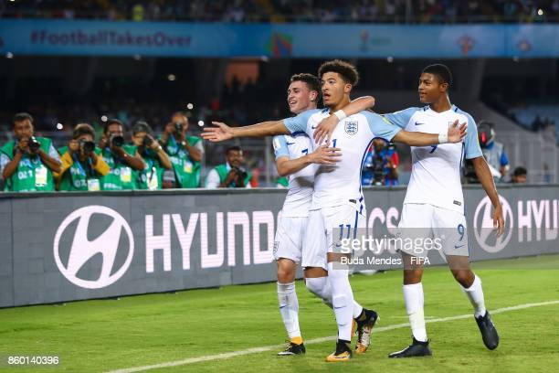 Jadon Sancho Rhian Brewster and Philip Foden of England celebrate after scoring a goal during the FIFA U17 World Cup India 2017 group F match between...