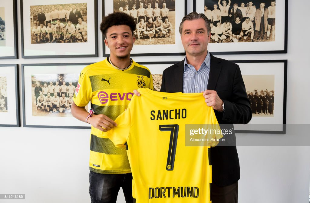 Jadon Sancho signs a new contract with Borussia Dortmund with Michael Zorc (sports director of Borussia Dortmund) on August 31, 2017 in Dortmund, Germany.