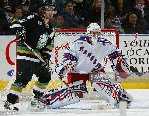 Jadran Beljo of the London Knights works next to Steve Mason of the Kitchener Rangers in a game on January 20 2008 at the John Labatt Centre in...