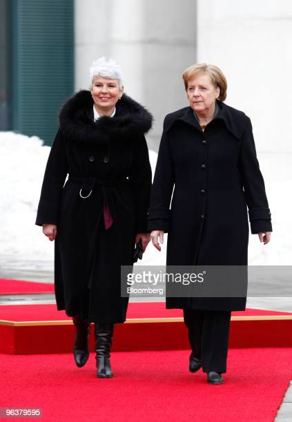 Jadranka Kosor Croatia's prime minister left is received by Angela Merkel Germany's chancellor at the German federal chancellory in Berlin Germany on...